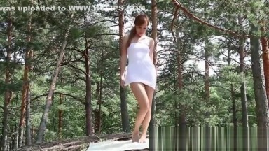 Hairy Russian babe Angie shows her hairy pussy outdoors