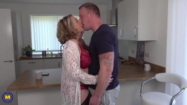 Naughty British housewife, Camilla C is getting her tattooed guy's huge dick, in her mouth