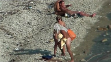 Couple fucking on a public beach, while walking past people